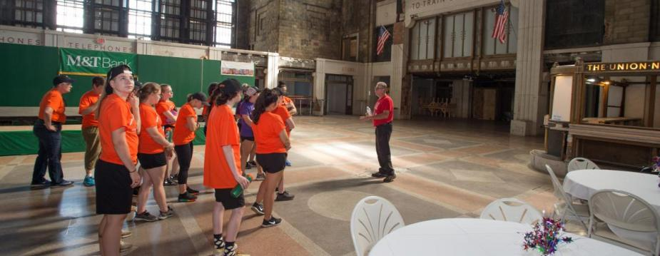 Students take instruction at the Buffalo Central Terminal which they are going to clean