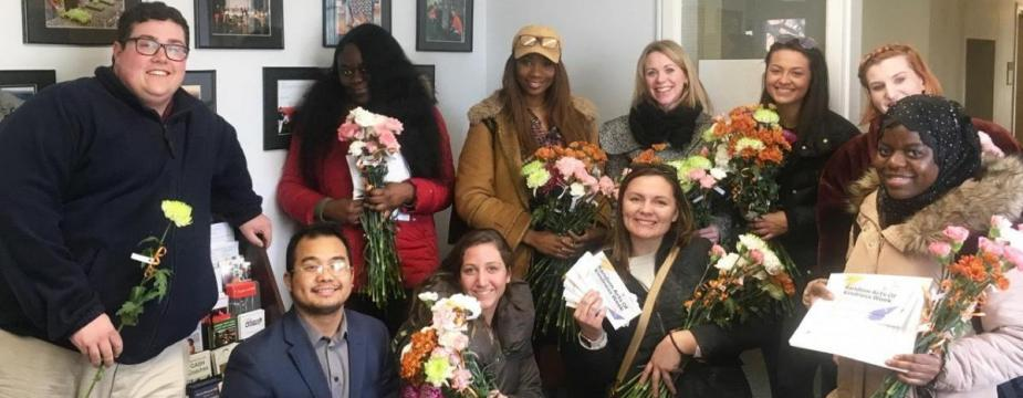 Student Civic Leadership Board gives out flowers for Random Acts of Kindness Week