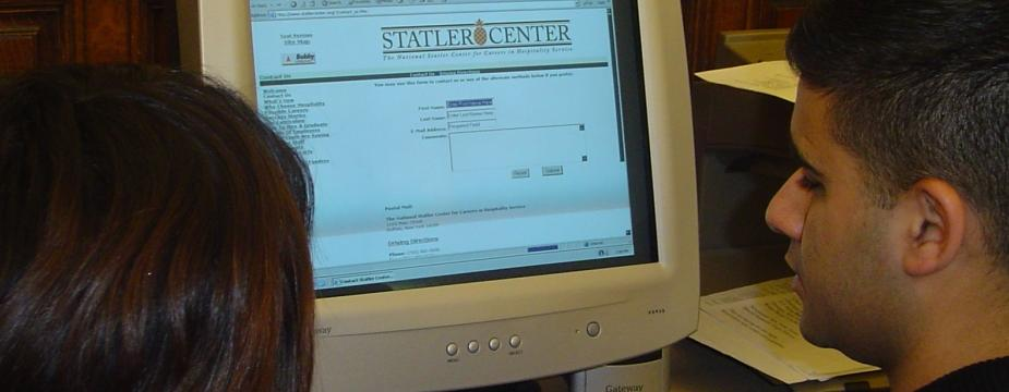 A Male and female student are exploring the Stater Center website.