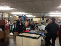 A group of people are sorting clothes